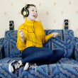 The girl at home listening to music through headphones — Stock Photo #9067109
