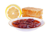 Honeycomb with jam at the plate — Stock Photo