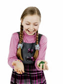 Little schoolgirl plays with a ball — Stock Photo