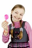 Little school girl looks in the mirror — Fotografia Stock