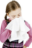 Little Schoolgirl treat a runny nose — Stock Photo