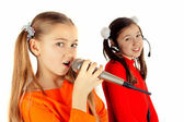 Beautiful girl singing into a microphone — Stock Photo