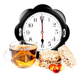 Hours at 6 pm tea and diet snacks — Stock Photo