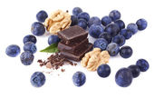 Handful of blueberries and slices of chocolate — Stock Photo