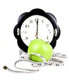 Measuring meter with watches and diet apple — Stock Photo