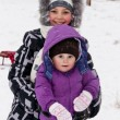 Little girls played with snow — Stock Photo #9174524