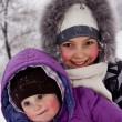 Little girls played with snow — Stock Photo #9174525
