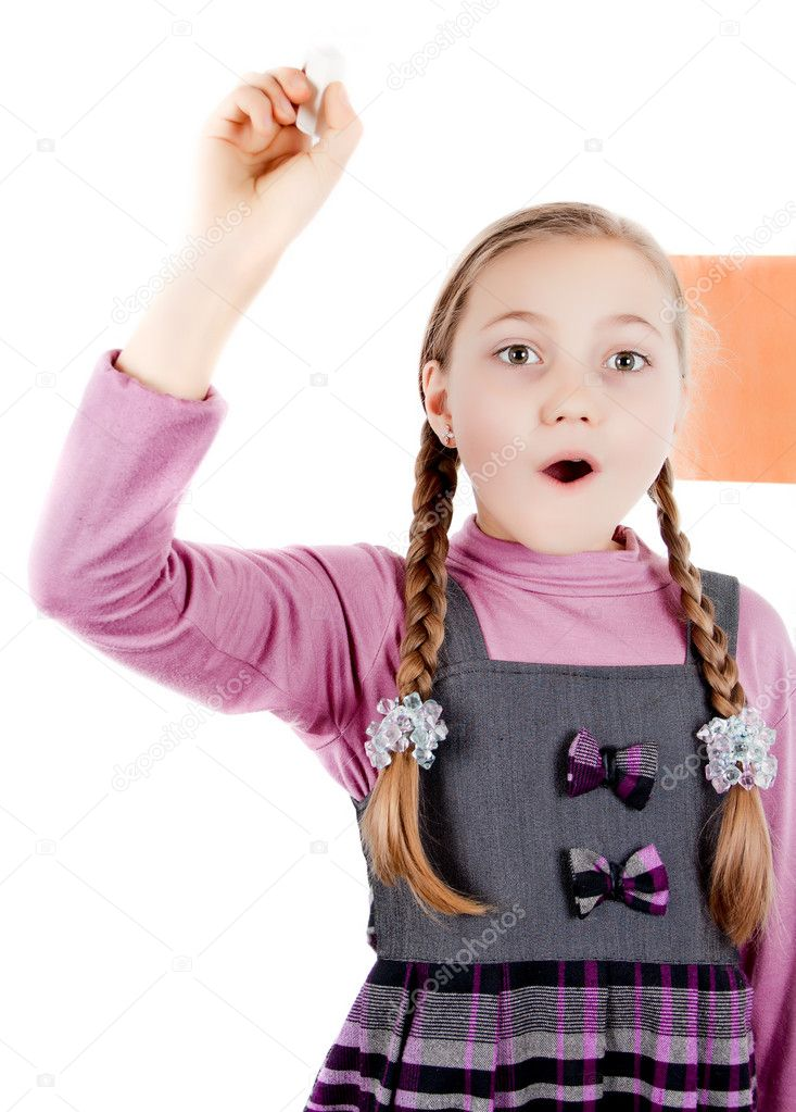 Little Schoolgirl writes with chalk — Stock Photo #9523527