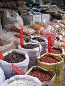 Spices, herbs and dried fish at asian market — Stock Photo