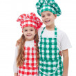 Stock Photo: Happy chefs - boy and girl with aprons and hats