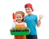 Happy spring gardening kids — Stock Photo