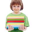 Litlle boy with freckles holding books — Stock Photo #10482164