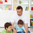 Father spending time with kids at home — Stock Photo