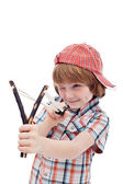 Mischievous kid aiming with sling — Stock Photo
