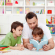 Father reading stories to his boys — Stock Photo #10584978