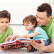 Reading time with father - Stock Photo