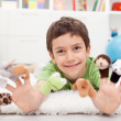 Boy with finger puppets - Stock Photo