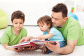 Reading time with father — Stock Photo