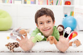 Boy with finger puppets — Stock Photo