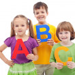 Children with abc letters — Stock Photo