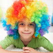 Young boy with clown wig — Stock Photo #10723732