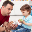 Father and toddler son playing — Stock Photo