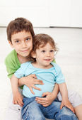 Brothers love - young boys sitting — Stock Photo