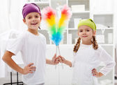 Room cleaning taskforce - kids with dust brushes — Stock Photo