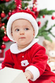 Baby girl and christmas tree - closeup — Stock Photo