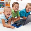 Happy kids with laptop computer — Stock Photo #8377931