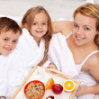 Stock Photo: Breakfast in bed for mother