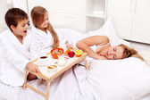 Rise and shine - breakfast in bed for mom — Stock Photo