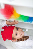 Little girl doing chores - dusting — Stock Photo