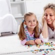 Stock Photo: Making a necklace for mom - little girl playing