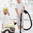 Stockfoto: Tidy up day - children cleaning their room