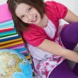 Stock Photo: Happy school girl with books and globe