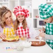 Woman and her daughters in the kitchen — Stock Photo