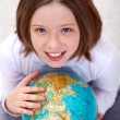 Young girl studying geography — Stock Photo