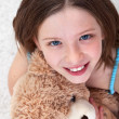 Stock Photo: Young girl with teddy bear