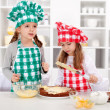 Little chefs making a cake — Stock fotografie