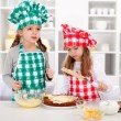 Stock Photo: Little chefs making a cake