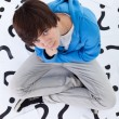 Stock Photo: Young teenager boy with lots of questions