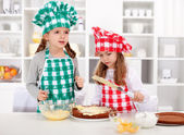 Little chefs making a cake — Stock Photo