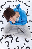 Young teenager boy with lots of questions — Stock Photo