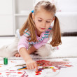 Little girl painting with finger — Stock Photo