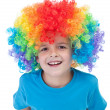 Stock Photo: Happy clown boy - isolated portrait