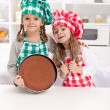 Little chefs baking a cake — Stock fotografie