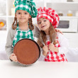Stock Photo: Little chefs baking a cake