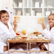 Breakfast in bed with happy kids — Stock Photo