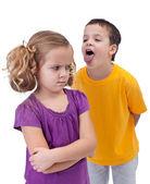 Molesta niña acosada por un chico mayor — Foto de Stock